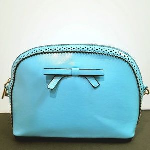 Bright blue structured purse with bow